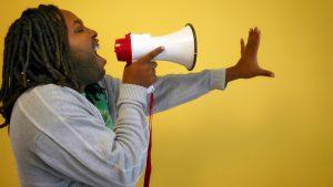 Man shouting on megaphone.